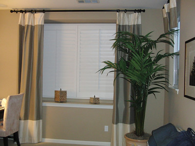 Master bedroom curtains and rods.