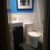 Newly renovated bathroom. Slate floor and subway tiles on the walls. If I was doing it again I might pick a darker blue, but it's pretty good.