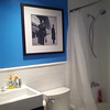 We kept the bathtub, but replaced the big metal shower frame with a curtain.