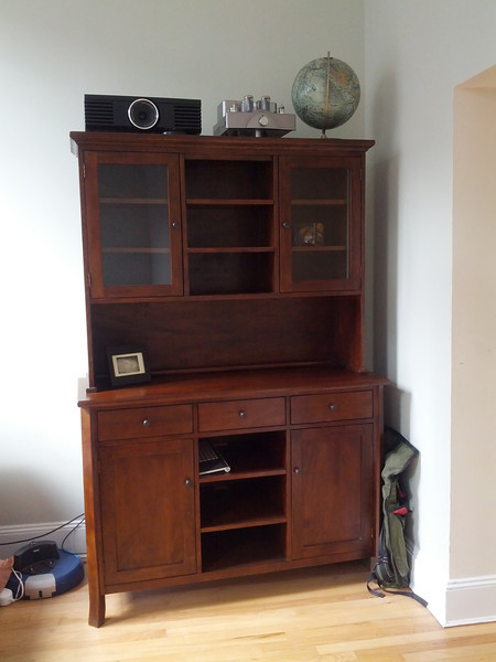 """Crate and Barrel calls this a """"buffet and hutch"""". I don't know what I call it, but it's a pretty useful piece of furniture. The shelves are adjustable too, which is nice. Maybe books will go in the middle. Not sure yet. I sort of hate the handles on the cabinets and drawers, but we can fix that later."""