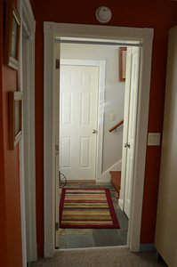Stairs to upstairs. Door to garage.