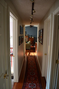 Hallway view out to living room and kitchen.