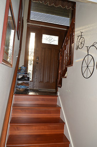 Stairs to front entry and upstairs.