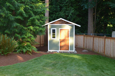 Custom built storage shed. 8' x 10' feet with work bench, shelves, and storage loft.