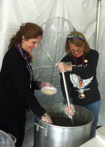 Cheryl & Kathy serving beans & rice
