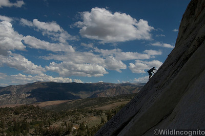 Climber steps up slabs on Mountain Light Wall Buttermilk Country