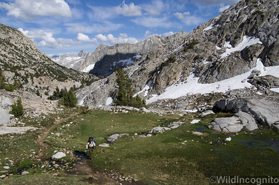Hiker Crossing through a High Country Hanging Meadow