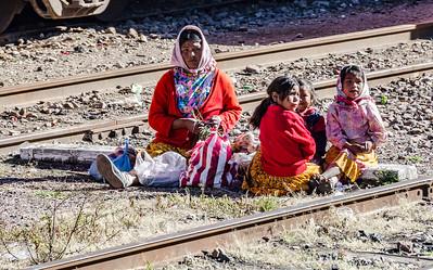 Tarahumara people beside the railway.