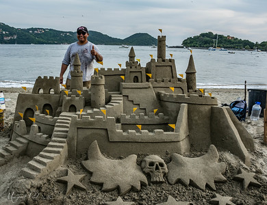 Daniel ... with one of his amazing sand sculptures... this time a castle... how original.1