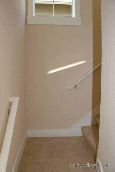 Stairs leading upstairs from the entryway... please hold the handrails and hold small children by the hand.