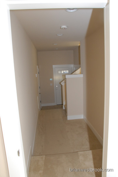 Leading out of the guest room toward the entryway. Watch your step...