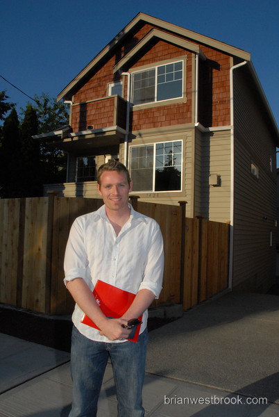 "This photo just screams ""Hi, I'm a homeowner!""  -- if Richard ever decides to go into the real estate business, I've got the perfect publicity photo.  Can you guess what's in the mysterious red folder?"