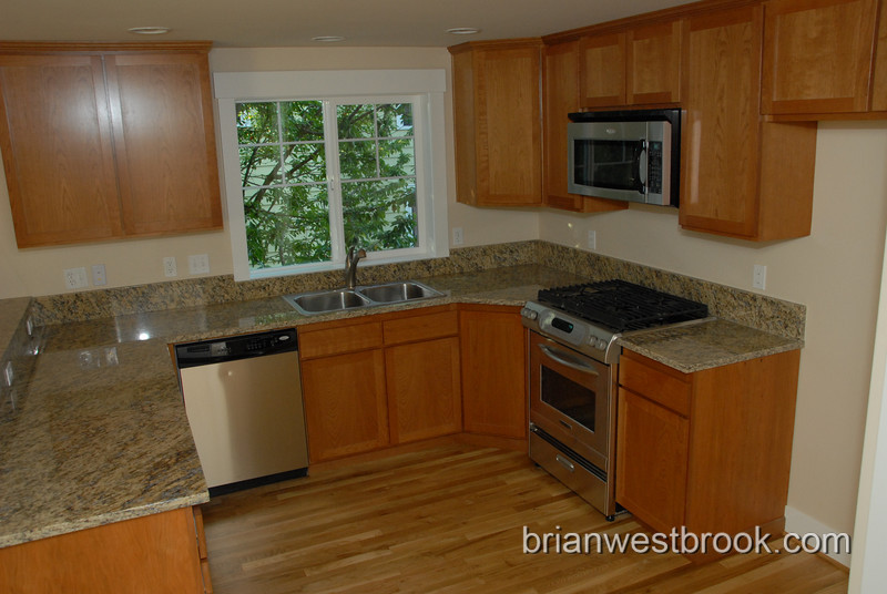 Kitchen close-up.  Spacious work prep area and gas range.  Lots of outlets.
