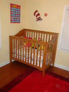 Bryan's latest handiwork:  an oak crib for the baby!  Notice also the Dr. Seuss Cat in the Hat hat painted by Bryan's brother.