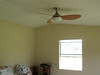 A new ceiling fan in the living room helps make that room look more complete.