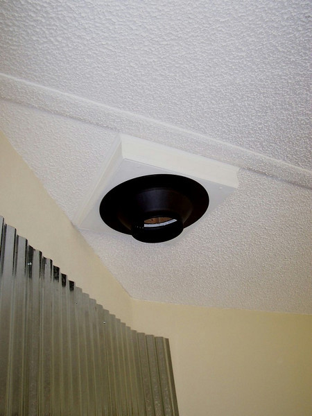 The finished stovepipe box makes a level spot in the sloped ceiling where the stovepipe will attach.