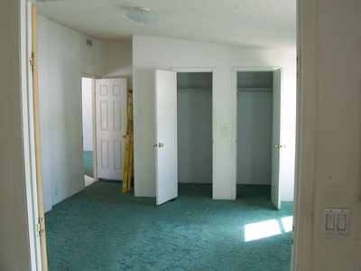 Pre-renovations: Looking back into the master bedroom from teh bath. Large walk-in closet will be a luxury compared to our current cramped closets. This room like al lthe others will be brightly painted and have wood floors.