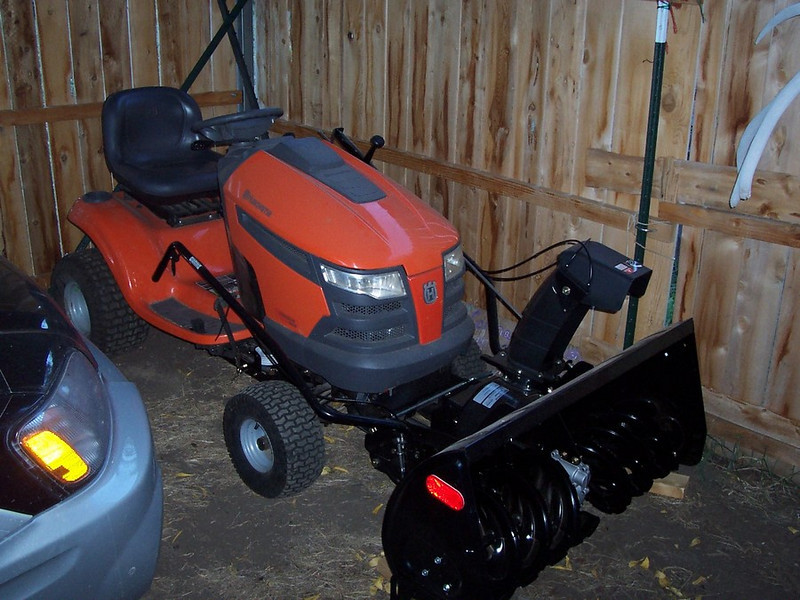 The lawnmower is ready for winter duty.