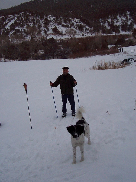 Chris tries out his cross-country skis in the back yard for the first time while Jester enjoys the snow.
