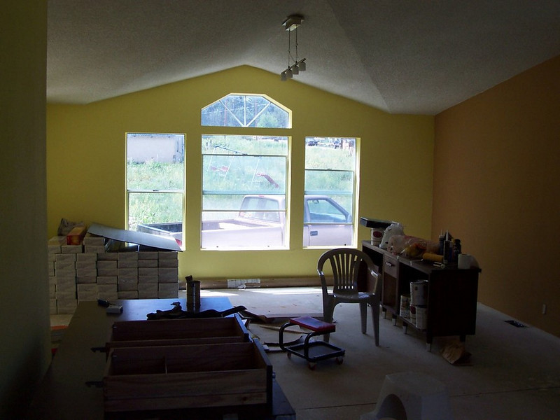 Mushroom tan walls make the yellow a little less shocking in the entry room.