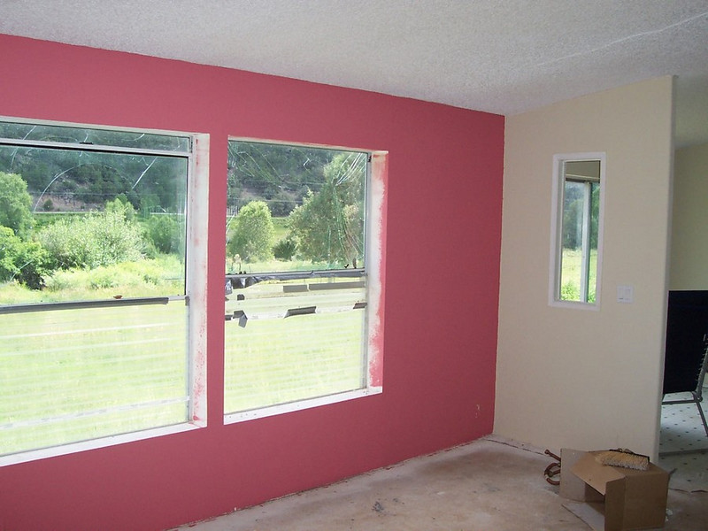 A rosy red accent wall in the living room.