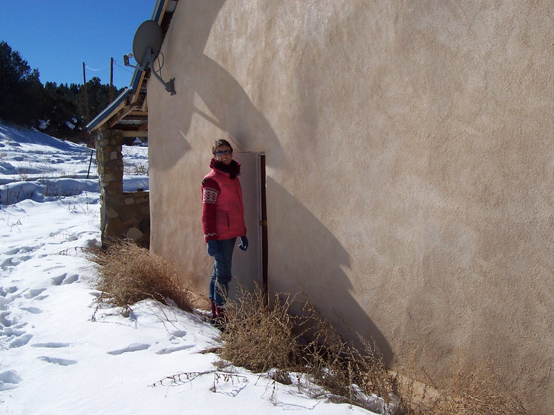 Caroline inspects one of the extremely short doors on the side of the adobe on New Year's Day.