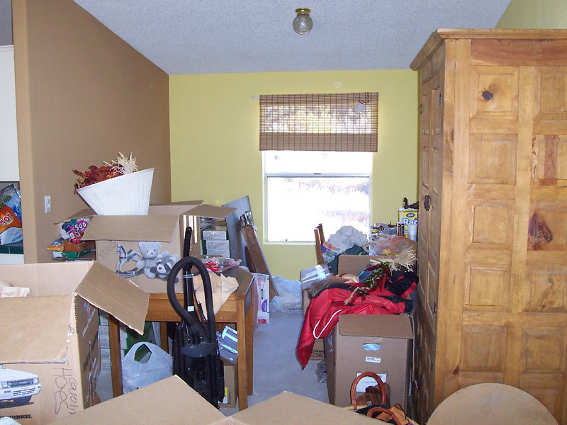 MOVING DAY: boxes and furniture piled in the office space of the entry room.