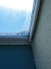 In single-digit temperatures, frost builds up on the inside of the metal framed windows.