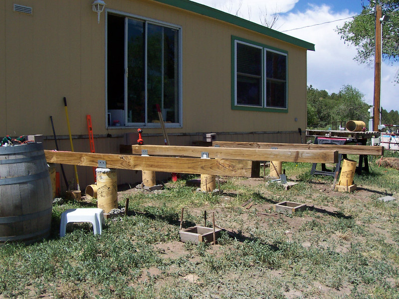 Six of nine support posts are done. These three beams and nine cement posts will support the entire deck.