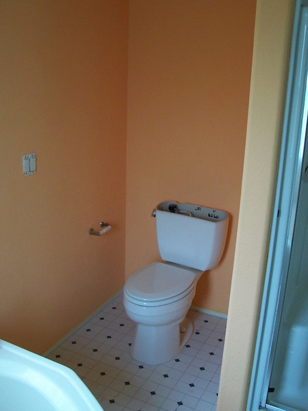 The walls around the toilet nook had to be painted before installing the new toilet.