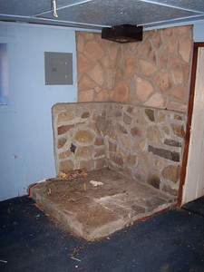 Niche for a wood burning stove in the adobe.