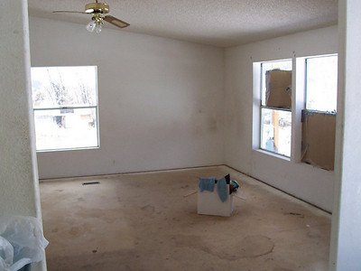 Pre-renovations:  This former dining room already had the carpet removed. We will make this into the living room after repainting and laying down wood flooring.