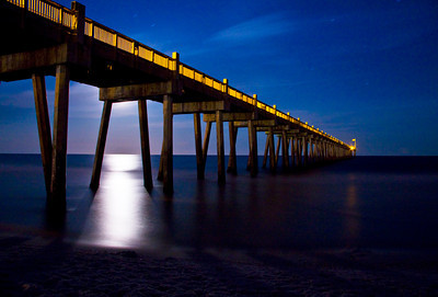 The beach pier in moonlight
