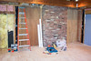Back side of fireplace (which will be stoned later) and the the new entrance to the rest of the house (boarded now).