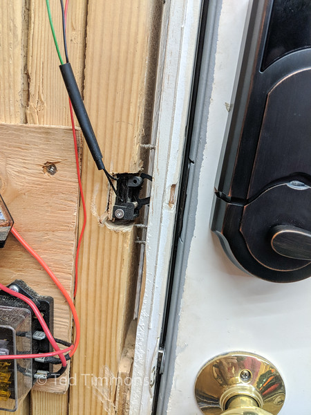 Microswitch that monitors the deadbolt status.