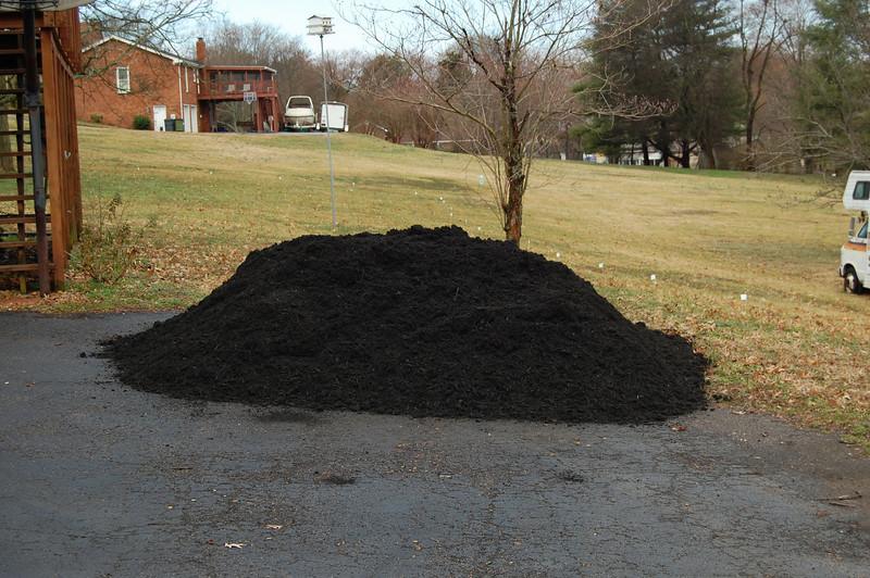 3/11/10;  Needham's delivered 9 yards of Midnight mulch