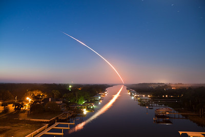 04/05/2010 6:21 am - STS-131 Space Shuttle Discovery launches into orbit in the minutes before dawn, leaving a beautiful reflection through the light fog on the Intracoastal Waterway in Ponte Vedra, Florida, 115 Miles from the launch. Click here to see a few more photos from that launch. I've been getting many questions about the settings I used for this photo; I shot this with a Canon EOS Rebel T1i and a Canon EF-S 17-55mm f/2.8 IS USM lens, at 17mm. Exposure settings were ISO 100, f/4.5, and 133 seconds.  Please feel free to  contact me if you have any further questions.  Thanks!