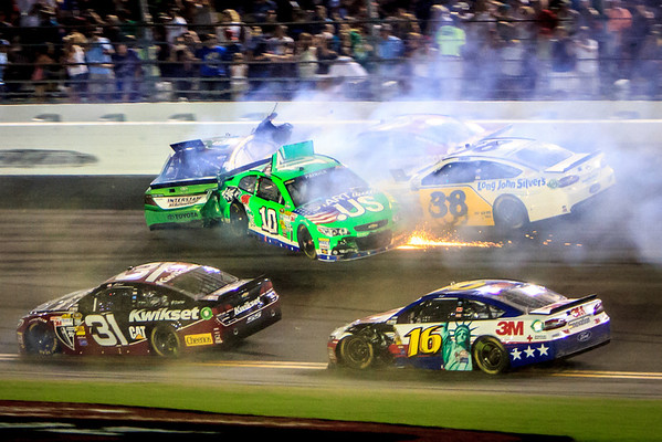 July 6, 2013: Kyle Busch, Danica Patrick, JJ Yeley and David Gilliland are collected in a finish-line crash at the Coke Zero 400 at Daytona International Speedway. -James Vernacotola