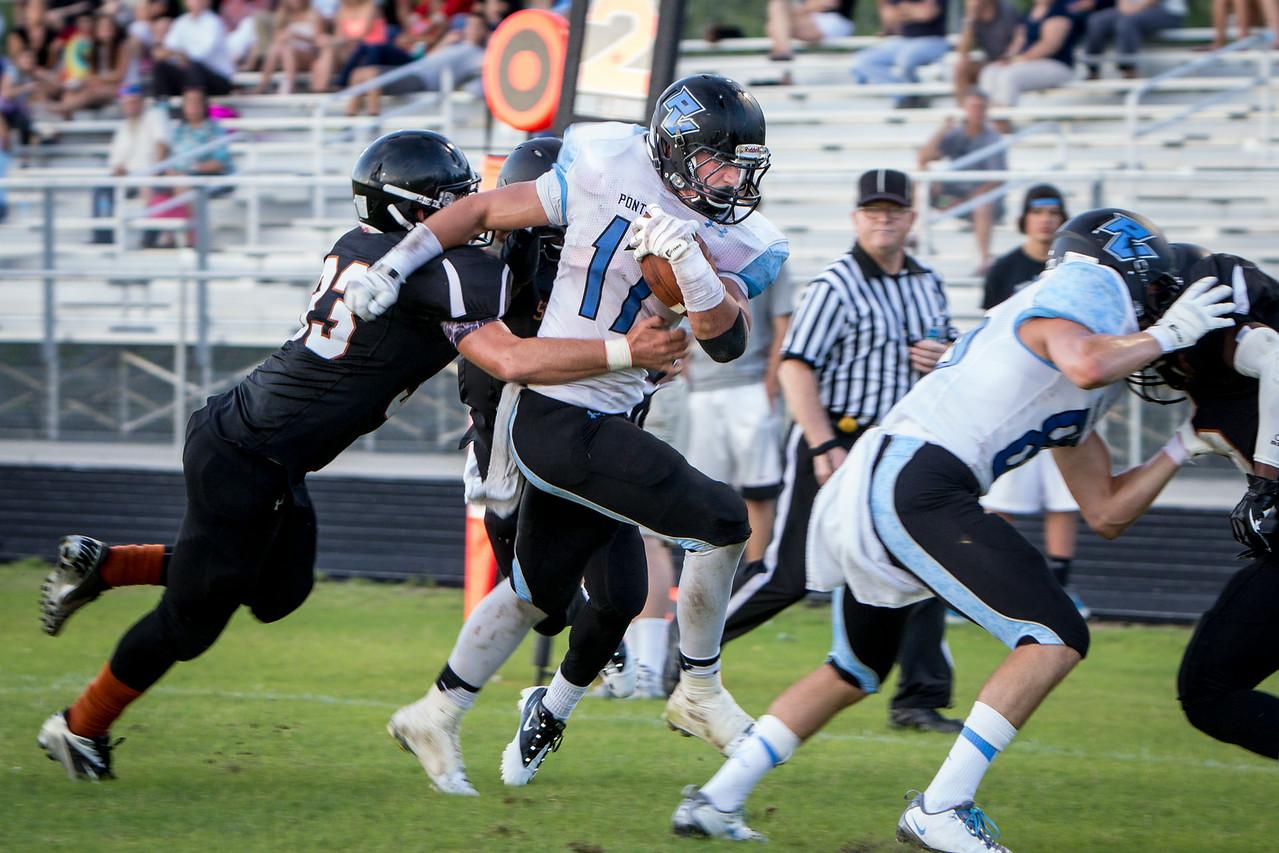 May 21, 2013: Ponte Vedra's Dillon Bates runs past Garrett Hopper of Atlantic Coast en route to a Ponte Vedra touchdown during the spring football game at Atlantic Coast High School. -James Vernacotola