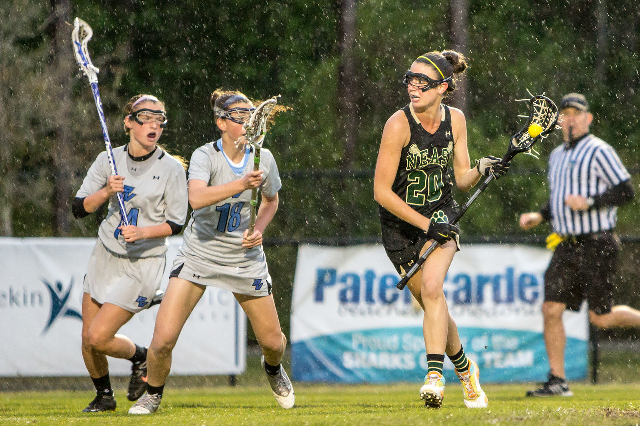 March 20, 2013: Jenna Smith runs past Jordan Grune and Abby Walker during a varsity lacrosse game at Ponte Vedra High School. -James Vernacotola