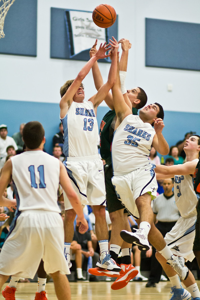 January 25, 2013: Armin Radoncic of Mandarin battles for the ball with Ponte Vedra's Brooks Bartley and Kellen Wilson during a basketball game at Ponte Vedra High School. -James Vernacotola