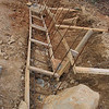"""This is the 2""""x4"""" forming for the footings.  Note the steel rods running lengthwise and the vertical<br /> steel rods that tie into the footing.  The spacing is every 24"""".  There is that rock that could not be moved."""