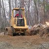 Bernice Proctor was a master at working that bulldozer.  He really tore up the hillside to get a widened driveway.  <br /> Turns out, the people who built the house put the phone line right up the middle <br /> of the driveway and paved over it.  Guess what?  No phone service.