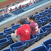 Kevin and Kayla watching some Phillies baseball, one of the eighteen innings