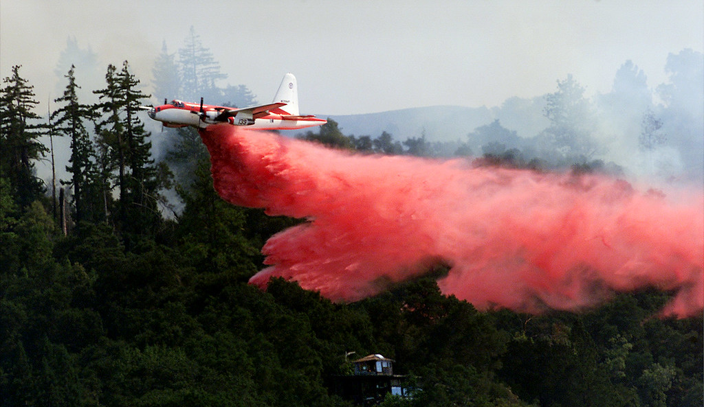 photo of a CDF air tanker makeing a drop to protect a cabin on the 4,500 acre UC santa cruz preserve near lucia. the fire is only a hundred yards from the structure.EDITORS NOTE: THIS WOULD LOOK GREAT IN OUR PAPER IF RAN AT LEAST 6 COLLUMNS. CATHARINE SAID ITS OK!