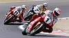 Pierfrancesco Chili, 7, Troy Corser, 11, chase down Carl Fogarty during the 1999 Laguna Seca Superbike Race.