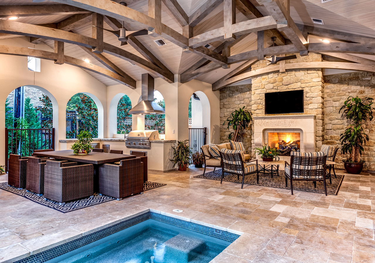 Outdoor air conditioned and heated patio with fireplace and hottub and pool