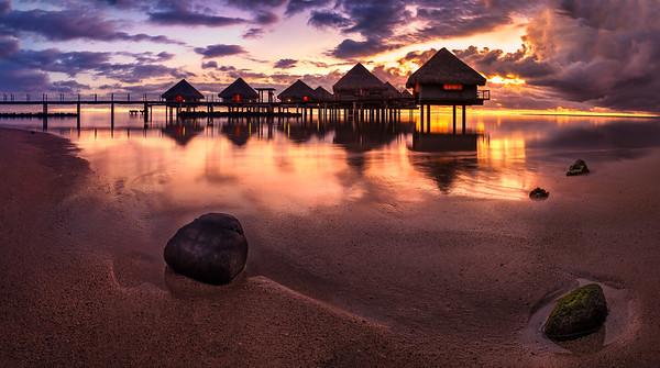 Tahiti bungalows with sunset near beach
