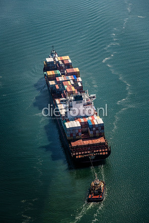 Containership Spyros V pulled into the Port of Rotterdam by two tugboats