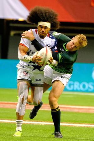Vancouver, Canada. 12th March, 2017. Folau Niua (7) of USA, battles for the ball with player of South Africa. Day 2 - Cup Semifinal HSBC Canada Sevens Rugby at BC Place Stadium. South Africa defeats USA 14-10. Credit: Joe Ng